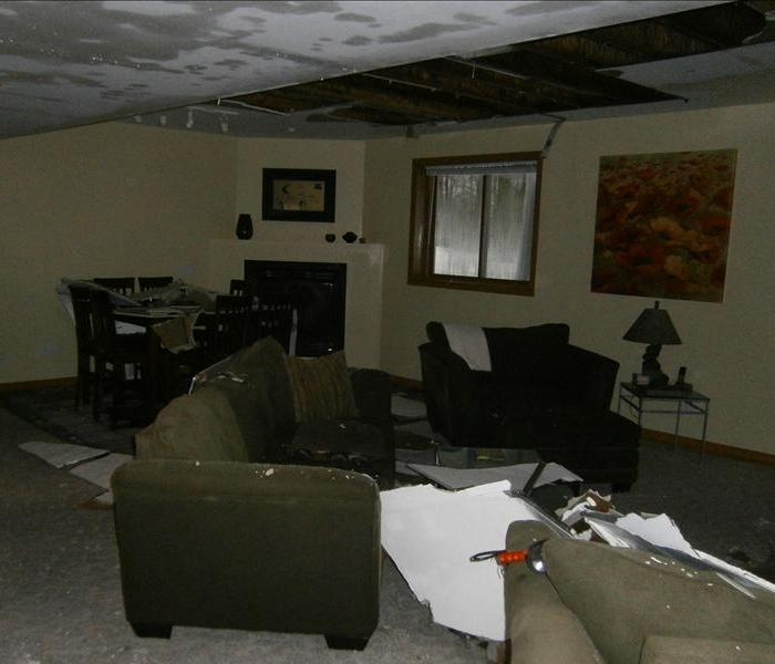 Condo basement affected by broken pipe on ceiling