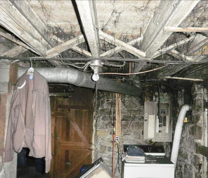Basement affected by water damage and covered by heave soot