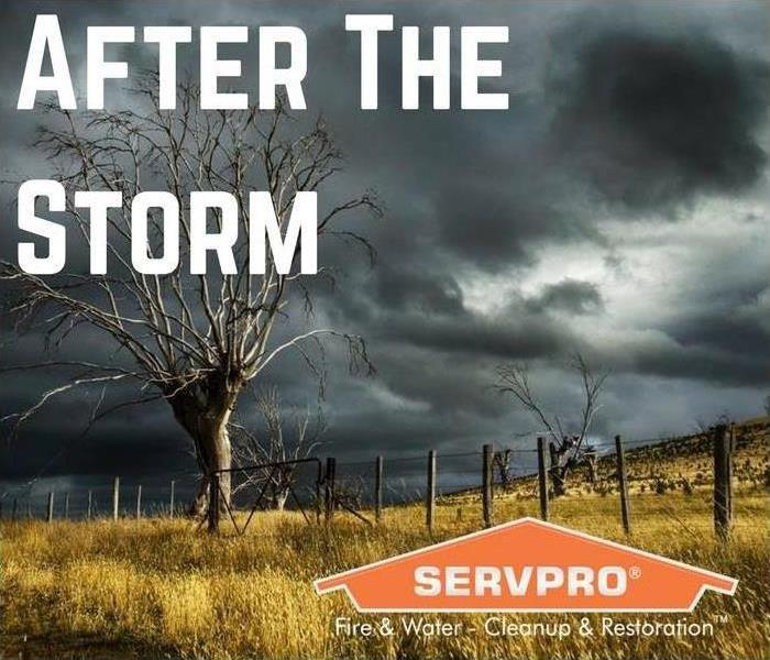 A view of a field and the skies are gray from a storm with SERVPRO logo and text saying After the storm