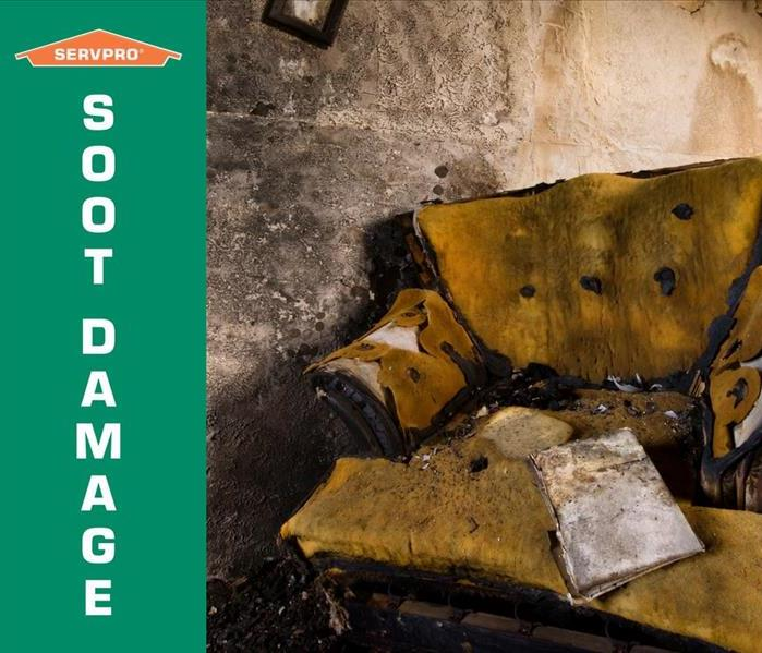 A room with walls and a chair covered in soot with SERVPRO logo and wording soot damage