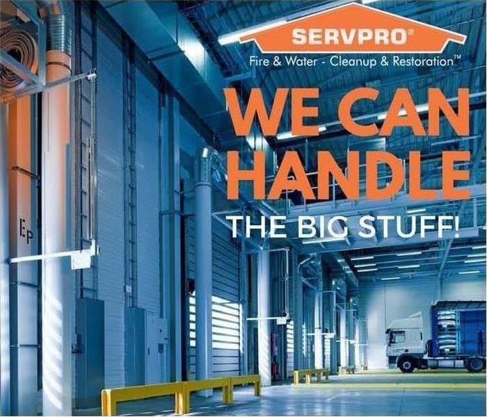 A warehouse with SERVPRO logo and text saying We can handle the big stuff