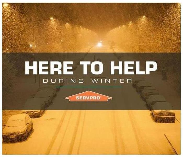 A night view of a snowed street with text Here to help during winter and SERVPRO logo