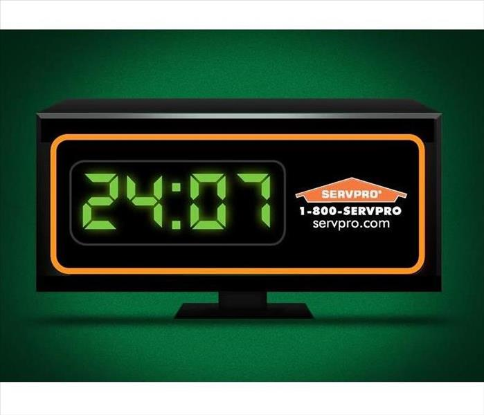 Green background with a clock with time at 24:07 and SERVPRO logo, phone and webpage