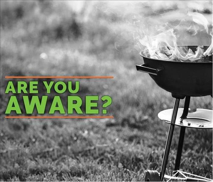 "an outside grill on a lawn with caption saying ""are you aware?"" referring to grilling safety"