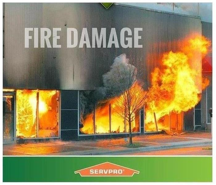 A business on fire with wording fire damage and SERVPRO logo